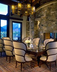 Love this dining Room. Dark wood and stone accent. ASPEN MANOR | Charles Cunniffe Architects