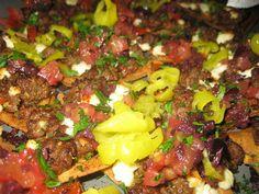 Stavros Nachos Greek style , lamb, feta, pepperochini, on pita chips