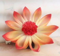 Red and yellow airbrushed kanzashi fabric hair flower with red cabochon center
