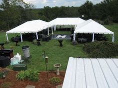 Set up of 3 frame tents in a U shape with the dance floor open air in the middle.