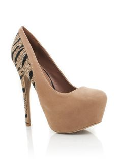 You'll be the queen of the jungle when you rock these tiger inset platform pumps.