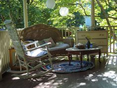 reminds me of my mom's porch. (with less furniture)