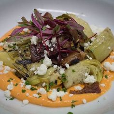 Grilled Artichoke Hearts topped with bacon, pickle puree and goat cheese, it's what your tastebuds have been looking for! Grilled Artichoke, Common Ground, Artichoke Hearts, Menu Items, Goat Cheese, Pickles, Grilling, Cabbage, Bacon