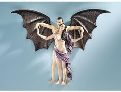"""Loves Infinity Wall Sculpture by Design Toscano. $24.95. Hand painted. Design Toscano exclusive. Cast in quality designer resin. """"Who steps in to claim this shapely maiden for the dark side? Famed artist Kaleb Martyn created a Gothic winged guardian who wastes no time retrieving this beauty for his camp. Our Toscano-exclusive collectible wall sculpture is cast in quality designer resin and intricately hand-painted to highlight each nuance of the fine sculpt.  18""""""""Wx4..."""