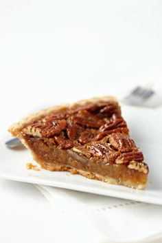 Easy Pecan Pie Recipe: Thanksgiving Dessert To Knock Their Socks Off The BEST tasting and easiest southern pecan pie recipe you've ever had. Impress them all with this pecan pie recipe Karo included! Köstliche Desserts, Delicious Desserts, Dessert Recipes, Southern Pecan Pie, Southern Recipes, Pie Recipes, Cooking Recipes, Thanksgiving Desserts, Pie Dessert
