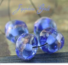 Sapphire Gold (4) petite organic shaped beads. Starting at $7 on Tophatter.com! http://tophatter.com/auctions/36529/standby
