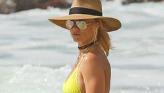 New story on InStyle: Britney Spears Flashes New Diamond Ring While Frolicking in Yellow Bikini Britney Spears Show, Trending Celebrity News, Rekindle Romance, Yellow Bikini, Justin Bieber, Selena Gomez, Fashion News, Cowboy Hats, Style Inspiration