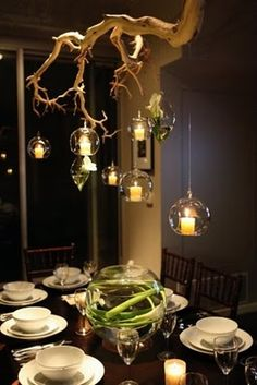 Ahh!! Awesome alternative to chandelier, and electric lights can hang down to allow for less candle use