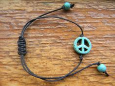 turquoise peace and love waxed cord bracelet choose color cord. $5.00, via Etsy.