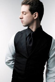 French pianist Bertrand Chamayou (from the cover of his César Franck album). Black vest and tie on matching black shirt front and collar, with white shirt sleeves. Classy, unique, worth trying. -RS