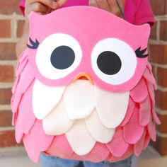 Tutorial: Pink Owl Trick-or-Treat Pail ~ a plastic pumpkin pail, pink and cream fleece, white glue, package of black and orange foam masks (purchased at Jo-Ann Fabrics and Crafts), and one sheet of white cardstock... this is adorable!