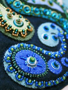 Dream Fragments (detail) - felt applique w/sequins, beads & buttons by Kerrin Quall Wool Embroidery, Embroidery Patterns, Paisley Embroidery, Penny Rugs, Felt Applique, Felt Art, Felt Ornaments, Felt Flowers, Fabric Art