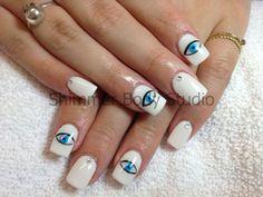 Gel nails, hand painted nails, eyes, crystals nail art by Shimmer Body Studio