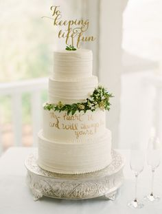 """Four tier wedding cake with """"to keeping life fun"""" topper: Photography: Lindsay Madden Photography - www.lindsaymaddenphotography.com Read More on SMP: http://www.stylemepretty.com/2016/12/06//"""