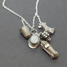 This fun necklace is made from vintage top hat, car, thimble and dog monopoly game tokens plus a black and white die. The game tokens hung from a 18