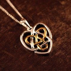 The Celtic sisters knot is a symbolic of an everlasting love. Shop exclusive Celtic Sisters Knot Necklace - Sisters Knot Jewelry and Celtic Sisters Knot jewelry Irish Christmas Traditions, Celtic Sister Knot, Knot Tattoo, Symbol Tattoos, Tatoos, Celtic Heart, Celtic Mythology, Irish Jewelry, Antique Jewelry