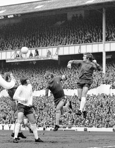 Tommy Baldwin of Chelsea loses out in the air as Spurs keeper Pat Jennings punches clear.