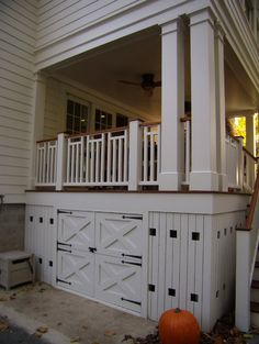 Deck Skirting Ideas - Under-the-porch storage cupboard. Have some extra room under the porch? Stop wasting that space and have it turned into a storage area, complete with latched doors. Under Deck Storage, Porch Storage, Storage Area, Storage Design, Extra Storage, Carport With Storage, Storage Place, Storage Room, Toy Storage
