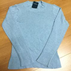 "Brandy Melville Blue Angelina Sweater NWT Lightweight pullover sweater in light blue with thick ribbing on the hem.  70% wool, 30%acrylic  22""length, 15""bust  Made In Italy  Color: Blue New with tag Brandy Melville Sweaters Crew & Scoop Necks"