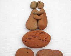 Pebble Art: 'I Love You Kiss' in Rust Stone on Canvas