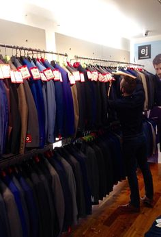 The Ej Menswear HALF PRICE SUIT SALE is now on!!! Quality suits in 2 piece and 3 piece available from €129! Pictured is staff member Peter Snee pricing some of our 1200+ suits on offer!