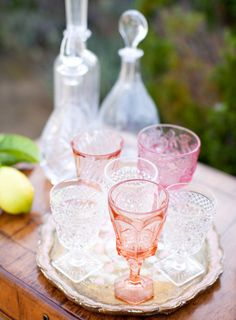a collection of rose hued vintage glass