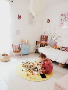 bright children's room with a rug for playing