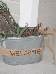 Simple front porch decorations for Winter for no cost at all. Use clippings from your Christmas tree and pine cones from the woods!