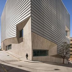The Public Library in Ceuta sits on a steep site, atop archeological excavations/ Paredes Pedrosa Arquitectos designs a compact building of concrete and aluminium that also maximizes the use of natural resources to reduce long-term energy costs/ Explore this project on #Architizer