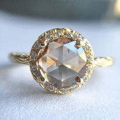 Bam. 1.75ct round rose cut cognac diamond in 18k yellow gold with white diamond pave on the band and setting.