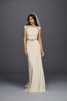 Wonder by Jenny Packham's sheath wedding dress feels vintage and modern all at once. The crystal embellished cap sleeves and waistband make it flattering, too. Exclusively at David's Bridal.