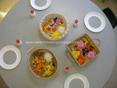 set up a provocation with the flowers, paper plates with the centers cut out, Contact paper (sticky side up), and glue.