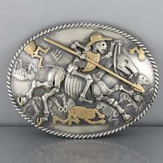 Mona Van Riper Don Quixote Sterling and 18K Gold Buckle Design Elements: Surround: Hand Twisted Sterling Wire Don Quixote: Sculptural Formed Body, Highlighted with Line Engraving…Shield, Hat, and Spear Tip in 18K Gold Skeletal Horse:Sculptural Formed Body, Highlighted with Line Engraving…Visible 18K Gold Horseshoes Buckle Field:Background Populated by 8 Spectral Skeletons, Three of These are …