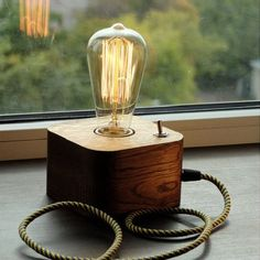 A wooden lamp designed for retro EDISON light bulbs.The lamp is made by hand from natural wood, polished and coated with Danish oil. Lampe Edison, Lampe Led, Edison Bulbs, Lampe Steampunk, Retro Lampe, Lampe Decoration, Edison Lighting, Track Lighting, Lighting Ideas