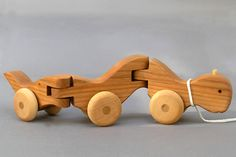 wooden articulated caterpillar pull toy