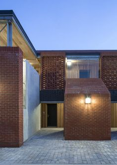 Hargood Close Diy Exterior Lighting, Patio Lighting, Brick Architecture, Amazing Architecture, Outside Light Fixtures, Architectural Materials, Brick Design, Brickwork, House Design