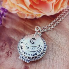 I Love You to the Moon and Back 3 layer engraved tags over a shiny silver filigree essential oil diffuser locket. Who do you love to the moon and back?