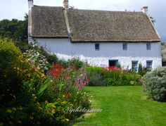 Cottage with summer flowers at the Ulster Folk Museum, Cultra,County Down, Northern Ireland.