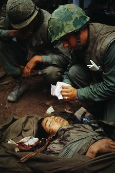 19 Feb 1968, Hue, South Vietnam --- U.S. Marine medics treat the head wound of a North Vietnamese soldier who was found below an outer citadel wall. --- Image by © Bettmann/CORBIS