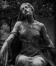 Weathered stone angel.  Sculptor and photographer unknown.