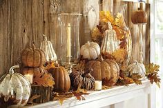 Thanksgiving mantle idea...lots of pumpkins, gourds, hurridcanes, candles, leaves