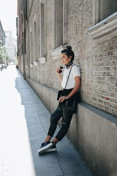 ONE TEE TWO OUTFITS - Lovely Pepa by Alexandra. White message t-shirt+black leather pants+white sneakers+black sweater+black crossbody bag+black bandana+black sunglasses+earrings. Spring Casual Outfit 2017