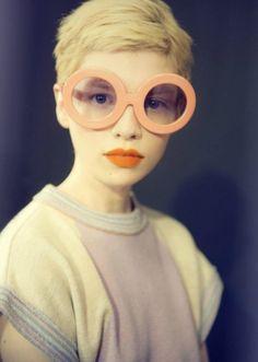 peach-salmon color eyeglasses pixie haircut The Shiny Squirrel