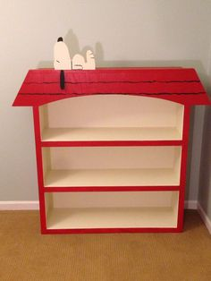 Built this Snoopy doghouse inspired bookshelf for my son due in September. Weekend well spent. - Imgur