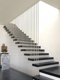 #Minimal design with a staircase screen of vertical #stainless #steel rods