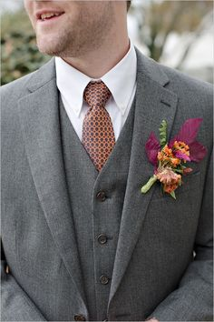 three piece grey suit and patterned tie #weddingchicks #groomstyle #graysuit http://www.weddingchicks.com/2013/12/18/fall-fantasy-wedding/
