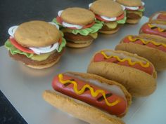 Hot Dog and Hamburger Cookies - I made these from the NFSC recipe with GeminiRJ's glaze for the mustard and cheese and fondant for the lettuce, tomatoes and wieners. They were for the May 2010 Cookie Club (I think! Maybe it was April - oh, well) and were such fun to make!