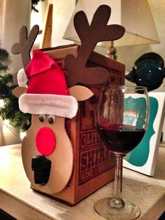 How to turn boxed wine into a classy Secret Santa gift . funny christmas presents Christmas Gift Quotes, Funny Christmas Presents, Christmas Gifts For Friends, Christmas Wine, Xmas Gifts, Easy Handmade Gifts, Handmade Christmas Gifts, Christmas Gift Wrapping, Homemade Christmas