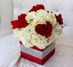 Wedding Flower Decoration Red roses and white hydrangeas in a red box. ****ITEM NUMBER: - Red roses and white hydrangeas in a red box. Wedding Table Centerpieces, Wedding Flower Arrangements, Flower Centerpieces, Flower Bouquet Wedding, Floral Arrangements, Centerpiece Ideas, Christmas Wedding Bouquets, Red And White Weddings, Red And White Wedding Decorations