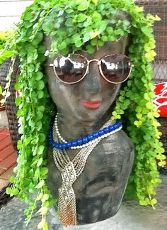 OMG...She's wearing Lipstick! This is just too COOL! Janet from Columbus Grove, OH writes: I love my head planter. She is the best conversation piece. We named her Toots, added jewelry, sunglasses and a little lipstick.